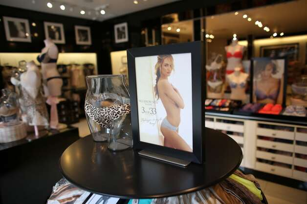 An image shows Supermodel Candice Swanepoel in the Victoria's Secret store.