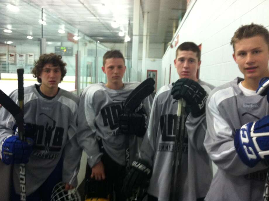 Four Capitol District area high school hockey players participated in the Hockey Night in Boston showcase tournament June 14-16 in Northford, Conn. The team included (from left) J.T. Rafferty (Saratoga High School, '15), Robby West (Christian Brothers Academy, '16), Peter Russo (Shenendehowa High School, '15), and Elliott Hungerford (Saratoga High School, '16).