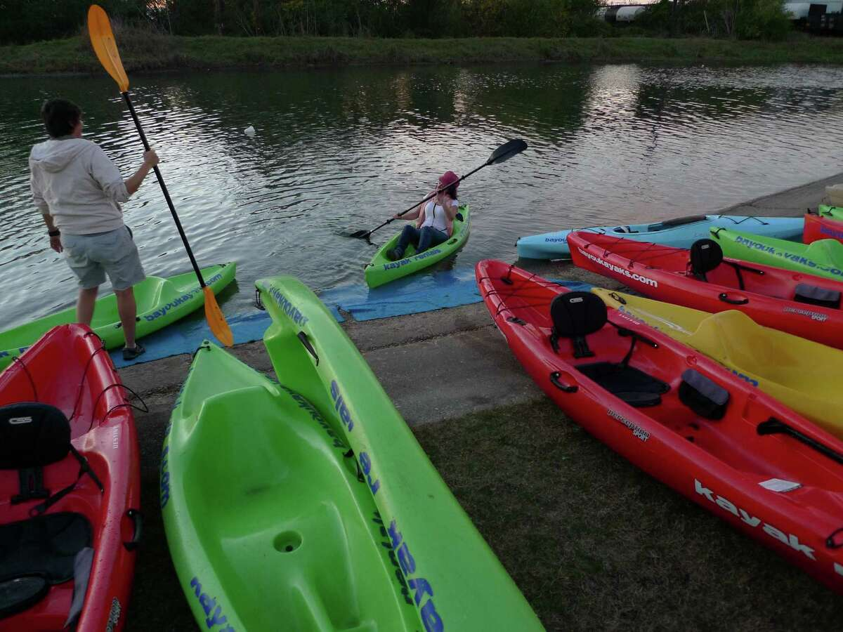Kayakers return from a trip along Bayou St. John in New Orleans. Bayou Kayaks is is one of several operators that offer kayak rentals on the waterway.