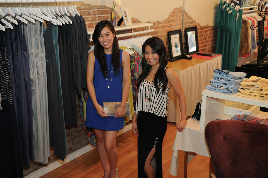 Sisters Thuy Pham, left, and Tuyet Pham recently opened WildBloom boutique in Rice Village. Photo: Jerry Baker, Freelance