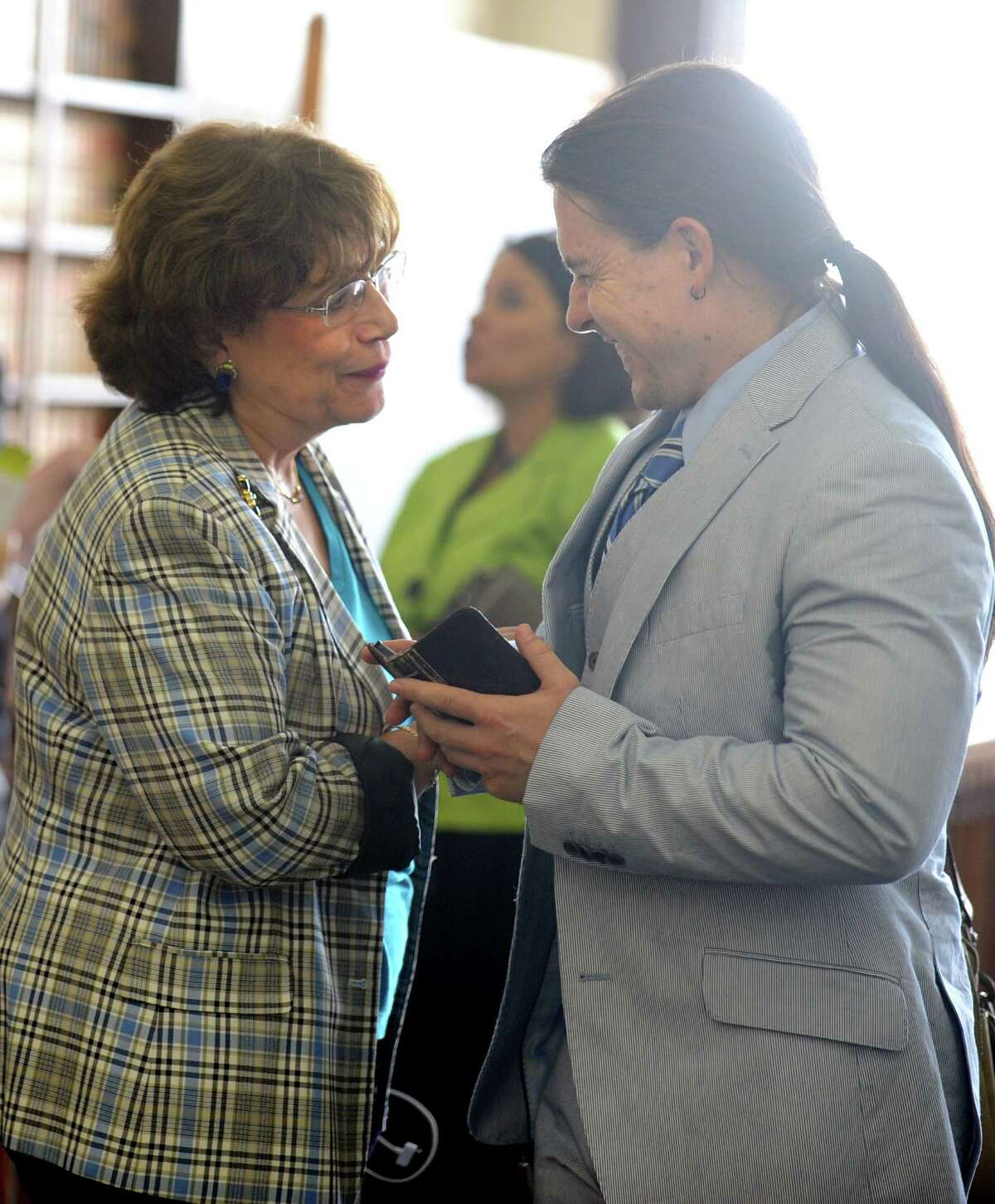 Plaintiff Carmen Lopez and Attorney Keving Smith talk following Judge Barbara Bellis's ruling to dissolve the stay that was keeping Paul Vallas in his job as Bridgeport Superintendent of Schools pending an appeal Wednesday, July 10, 2013 in Bridgeport Superior Court.