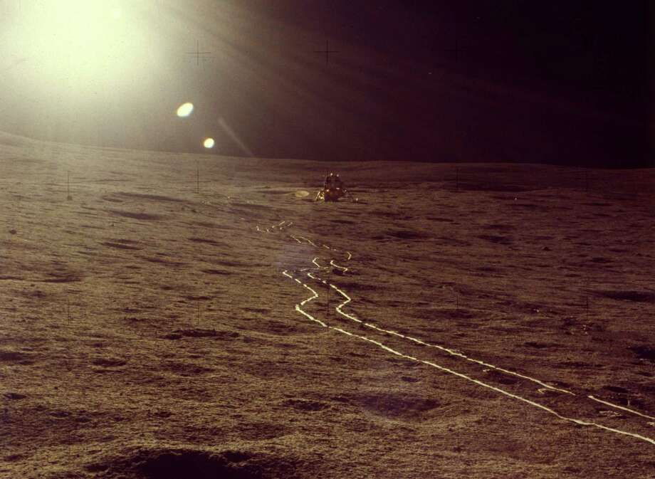 The tracks of a moon rover are shown on the lunar surface during the Apollo 16 mission, in April 1972. Photo: MPI, Getty Images / Archive Photos