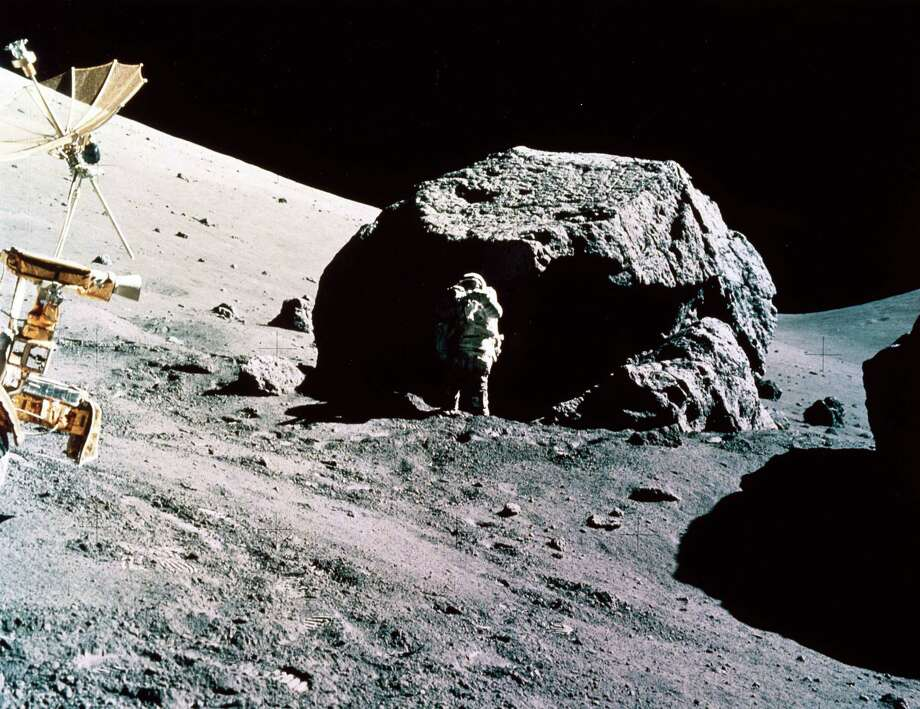 Astronaut Harrison Hagan Schmitt collects samples by a large lunar boulder, with part of the Lunar Rover in the foreground in this picture from the December 1972 mission. Photo: Science & Society Picture Librar, SSPL Via Getty Images / Please read our licence terms. All digital images must be destroyed unless otherwise agreed in writing.