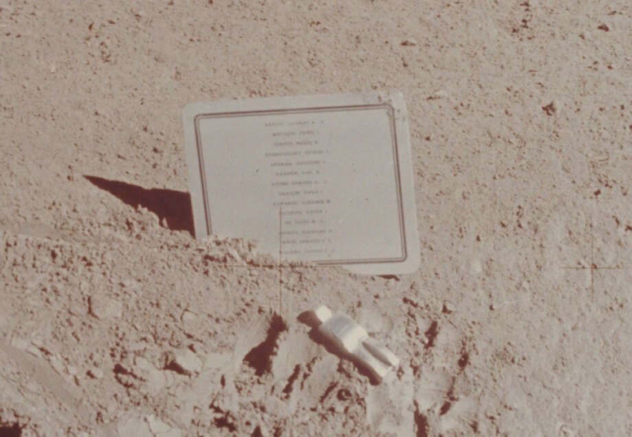 This commemorative plaque was left at the Hadley-Apennine landing site on the moon during the Apollo 15 mission, on August 1, 1971. It bears the names of 14 deceased astronauts and cosmonauts, and is accompanied by a small aluminum sculpture entitled 'The Fallen Astronaut.' Photo: Space Frontiers/Getty Images