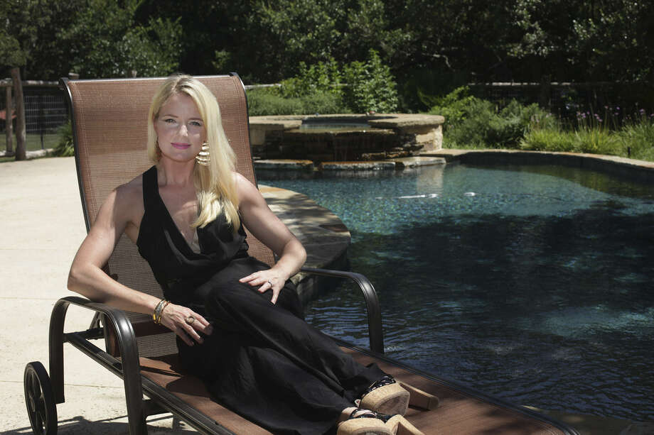Area stylist Erin Busbee relaxes poolside. Her advice to women? If you're not doing yoga, lose the yoga pants. Photo: Photos By Abbey Oldham / San Antonio Express-News