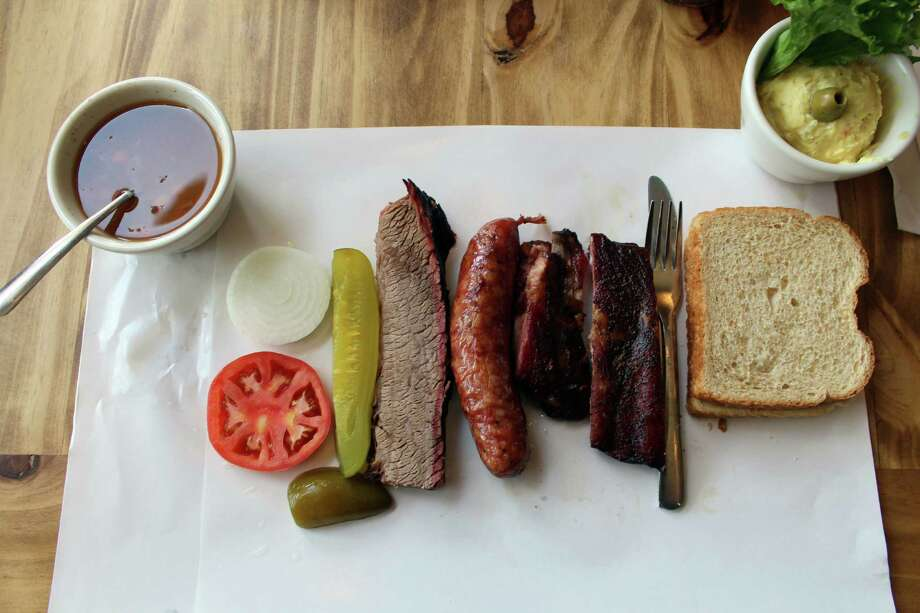 Slow-smoked brisket, sausage and pork spare ribs are the meat offerings at Cotten's Barbecue. Brisket is available lean or marbled; sliced or chopped. Photo: Jennifer McInnis / San Antonio Express-News