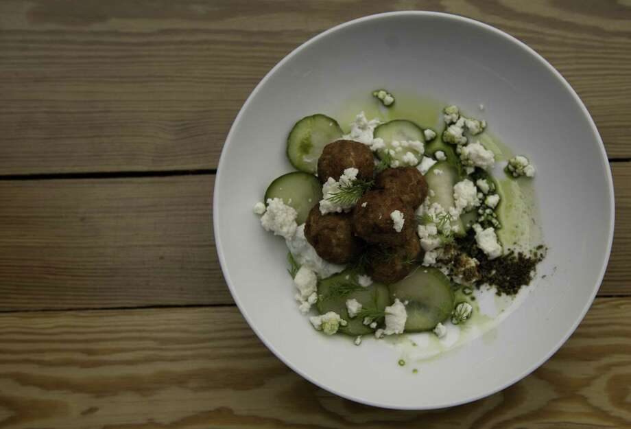The Monterey offers inventive and playful cuisine such as the chicken meatballs shown here. The restaurant is a favorite among visiting chefs and food experts. Photo: Express-News File Photo