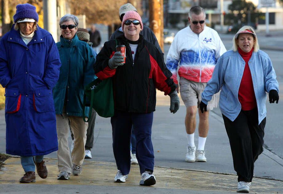 The Randolph Roadrunners Volkssport Club doesn't let cold or heat interfere with its walks. Volksmarchers will be heading out again Saturday morning. We're betting coats won't be necessary. Photo: Express-News File Photo