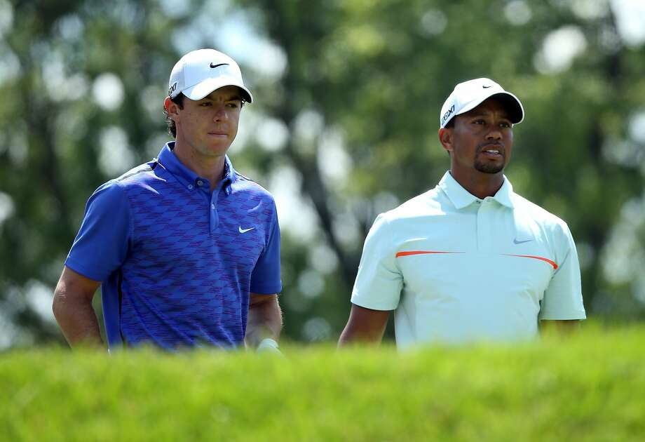 ARDMORE, PA - JUNE 15: (L-R) Rory McIlroy of Northern Ireland and Tiger Woods of the United States look on from the fourth tee during Round Three of the 113th U.S. Open at Merion Golf Club on June 15, 2013 in Ardmore, Pennsylvania.  (Photo by Andrew Redington/Getty Images) Photo: Andrew Redington, Getty Images