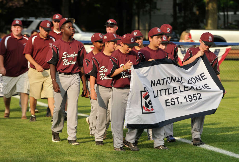 The Stamford National Little League team takes the field during the Little League District 1 opening ceremony at Michael J. Drotar Park in Stamford on Tuesday, June 25, 2013. Photo: Jason Rearick / Stamford Advocate