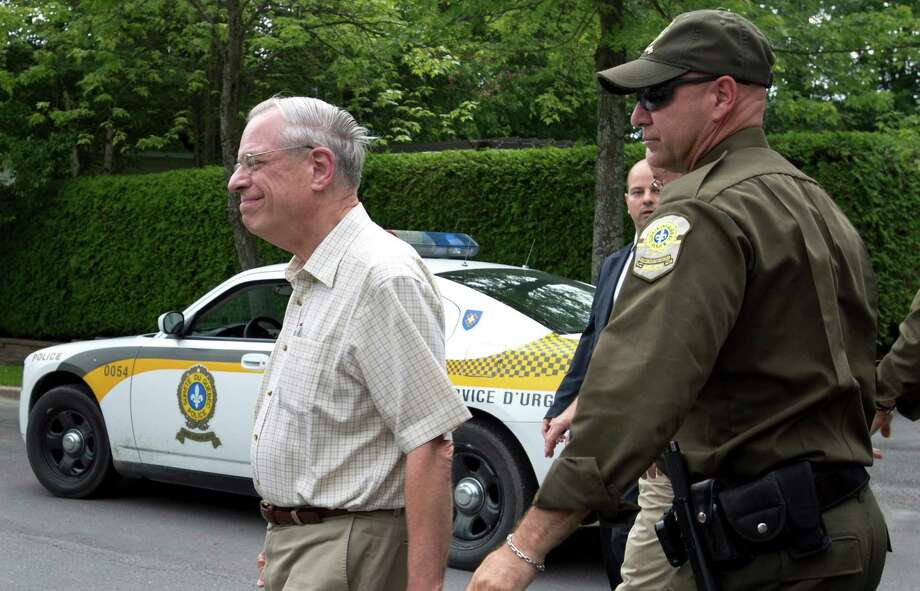Rail World Inc. president Edward Burkhardt is escorted by police as he tours Lac-Megantic, Que., on Wednesday, July 10, 2013.    A Rail World oil train derailed in the town killing at least 15 people.  (AP Photo/The Canadian Press, Paul Chiasson) Photo: Paul Chiasson, SUB / CP