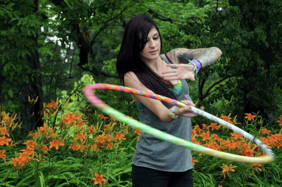 Joleena Canfield of Buffalo practice with her hula hoop as she and her husband wait for the gates to open at Camp Bisco on Wednesday July 10, 2013 in Pattersonville, N.Y. (Michael P. Farrell/Times Union) Photo: Michael P. Farrell / 00023099A