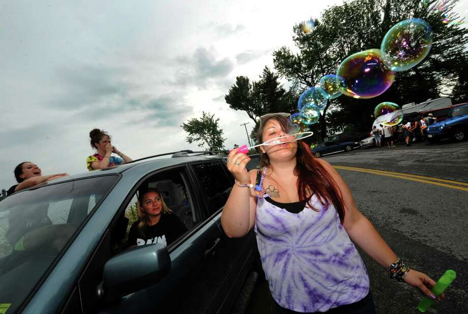 Autum Shaw-Dah of New Jersey bows bubbles while she and friends wait till the gates of Camp Bisco open on Wednesday July 10, 2013 in Pattersonville, N.Y. (Michael P. Farrell/Times Union) Photo: Michael P. Farrell / 00023099A