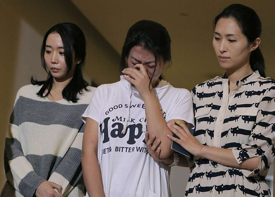 Cabin Manager Lee Yoon-hye (right), comforts other flight attendants from Asiana Airlines Flight 214, at a brief news conference at SFO in San Francisco, Calif. on Wednesday, July 10, 2013. Photo: Paul Chinn, The Chronicle
