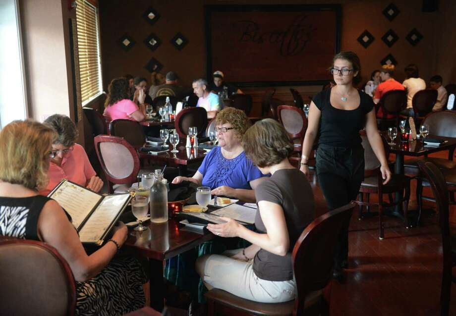 Customers dine at Biscotti's Ristorante in New Fairfield, Conn. on Wednesday, July 10, 2013.  Biscotti's specializes in Italian cuisine with catering and banquet parties also available. Photo: Tyler Sizemore / The News-Times