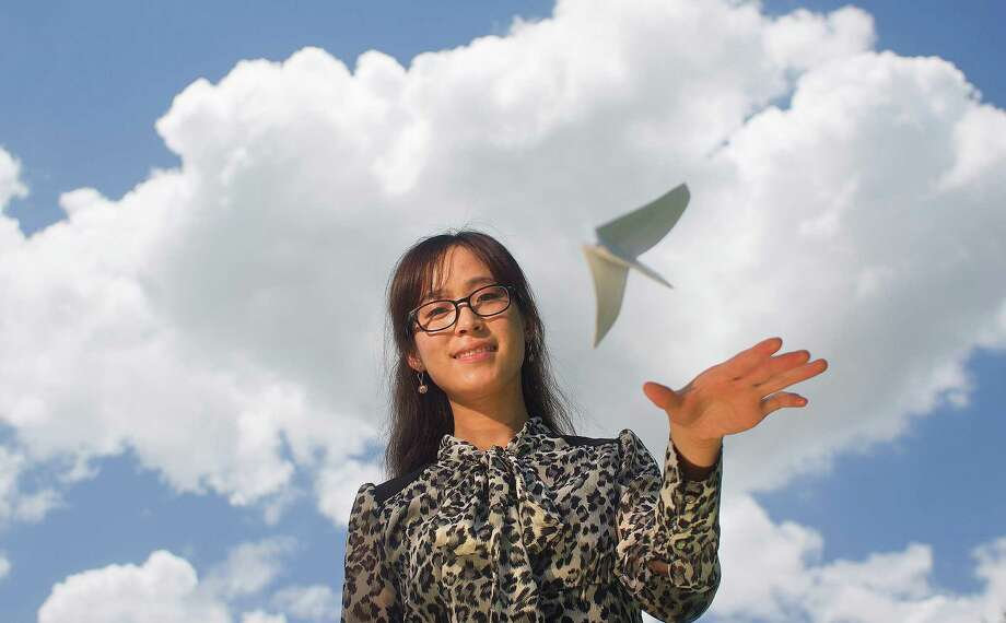 Nonstop flights home to Beijing are no longer just an idea to toy with for Houston grad student Jodie Wang, 26. Photo: Johnny Hanson, Staff / © 2013  Houston Chronicle