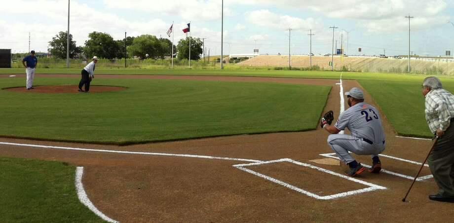 Bexar County Judge Nelson Wolff throws the first pitch - a strike - at the Missions Baseball Academy on the West Side. The four-field facility will be the home of the San Antonio Men's Senior Baseball League, and was funded with $4 million from Bexar County venue tax funds. Photo: Eva Ruth Moravec, San Antonio Express-News / San Antonio Express-News