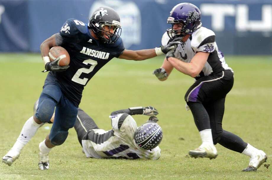 Ansonia's Arkeel Newsome fends off North Branford's Dale Hausman during the Class S state football championship game Saturday, Dec. 8, 2012 at Rentschler Field in East Hartford, Conn. Photo: Autumn Driscoll / Connecticut Post