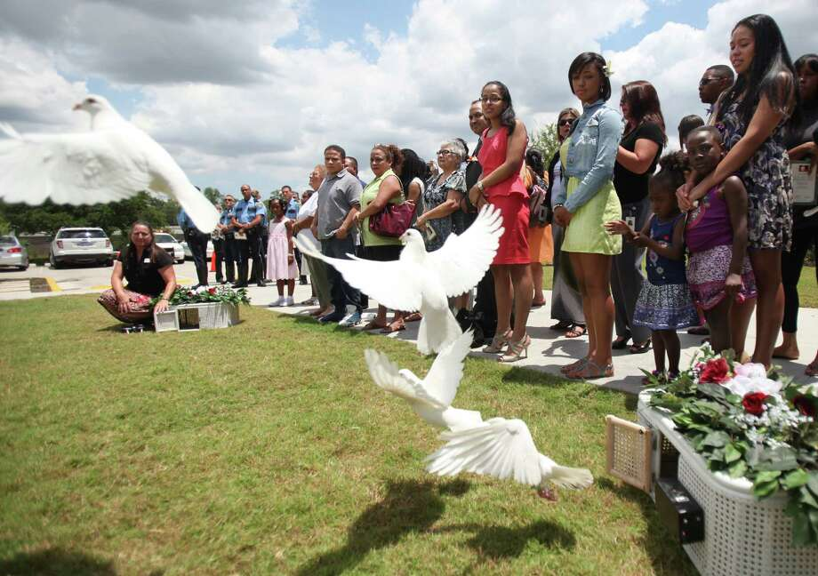 "Doves were released in honor of foster child Lee'Ona ""Lilly"" Ramirez during her memorial service at Brookside Funeral Home on Wednesday, July 10, 2013, in Houston. Photo: Mayra Beltran / © 2013 Houston Chronicle"