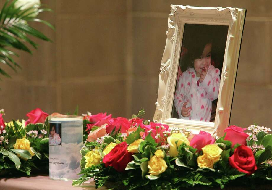"""A photo sits in the center of chapel during the memorial service for Lee'Ona """"Lilly"""" Ramirez at Brookside Funeral Home on Wednesday, July 10, 2013, in Houston. Photo: Mayra Beltran / © 2013 Houston Chronicle"""