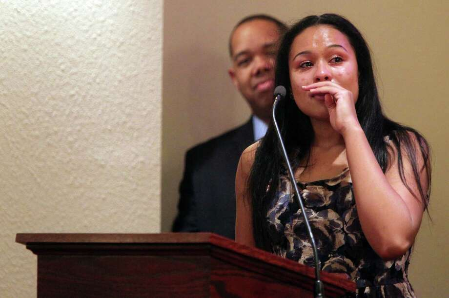 "Kaila Marroquin, daughter of the foster parents, delivered an emotional speech as she took a moment to recollect during the memorial service of Lee'Ona ""Lilly"" Ramirez at Brookside Funeral Home on Wednesday, July 10, 2013, in Houston. Photo: Mayra Beltran / © 2013 Houston Chronicle"