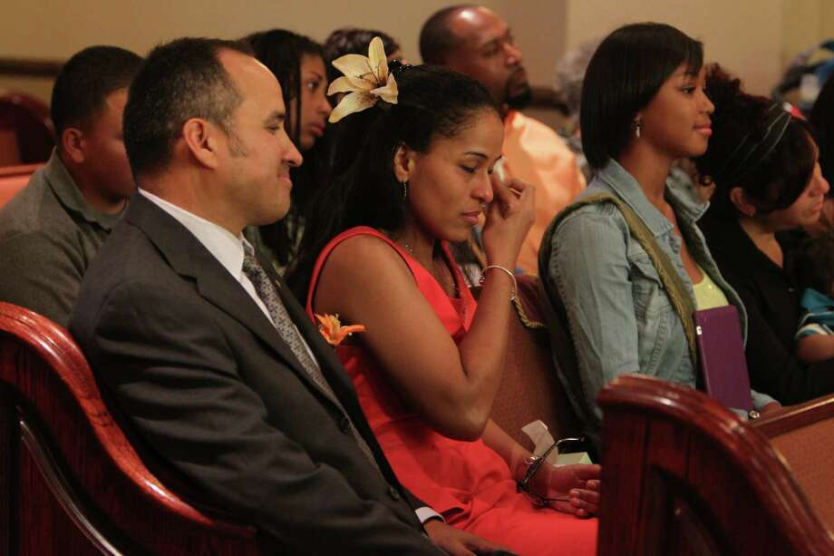 "Foster parents Patrick Hernandez and Kischa Hernandez listen to emotional remarks by daughter Kaila Marroquin during the memorial service for foster child Lee'Ona ""Lilly"" Ramirez at Brookside Funeral Home on Wednesday, July 10, 2013, in Houston. Photo: Mayra Beltran / © 2013 Houston Chronicle"