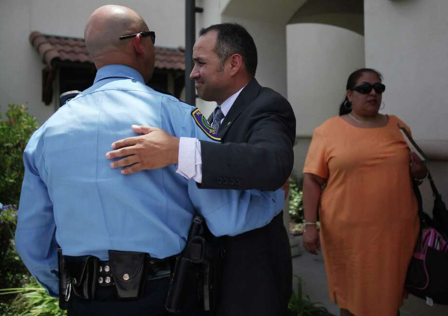 "Houston Police Officers pays respect to foster parent Patrick Hernandez right after a dove release in honor of foster child Lee'Ona ""Lilly"" Ramirez during a memorial service at Brookside Funeral Home on Wednesday, July 10, 2013, in Houston. Family and friends attended the memorial service to celebrate the life of Lee'Ona ""Lilly"" Ramirez. Photo: Mayra Beltran / © 2013 Houston Chronicle"