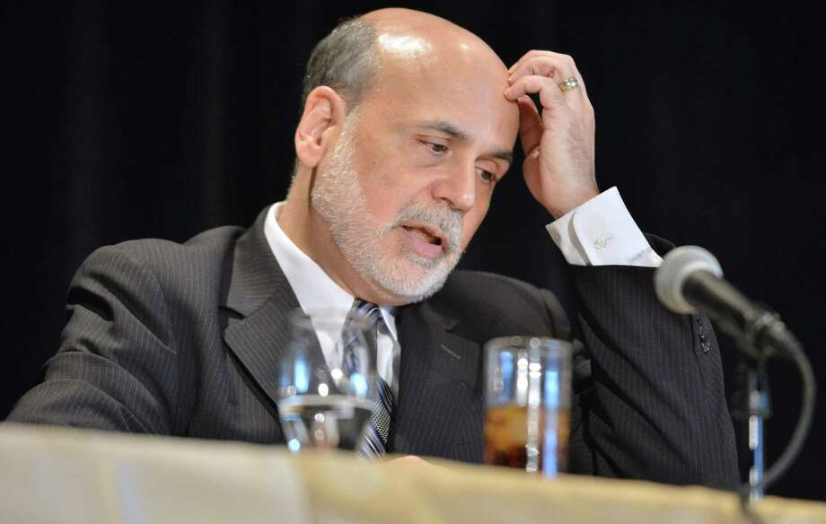 Federal Reserve Board Chairman Ben Bernanke responds to a question during a talk at the National Bureau of Economic Research Wednesday, July 10, 2013, in Cambridge, Mass. Bernanke spoke after the markets closed with stocks fluctuating between small gains and losses Wednesday morning, before the Federal Reserve released minutes from its most recent meeting. (AP Photo/Josh Reynolds) Photo: JOSH REYNOLDS, FRE / FR25426 AP