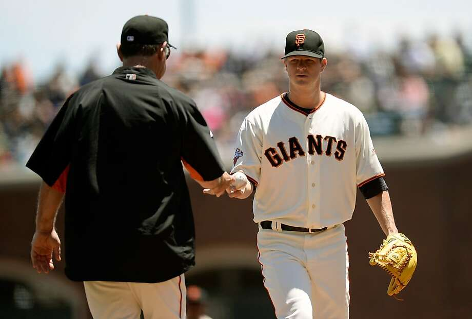 Giants manager Bruce Bochy takes the ball from starter Matt Cain, who got two outs in the shortest outing of his career. Photo: Thearon W. Henderson, Getty Images