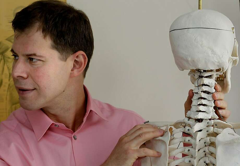 Dr. Dimitriy Kondrashov uses a skeleton to explain the injuries sustained by one of the crash victims that he treated. Photo: Brant Ward, The Chronicle