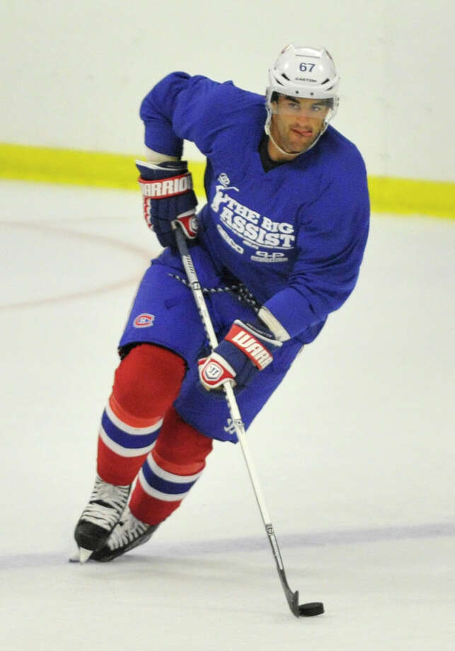 Max Pacioretty, of the Montreal Canadiens, skates with the puck during the Big Assist V charity hockey game at Terry Conners Rink in Stamford on Wednesday, July 10, 2013. Proceeds benefit the Obie Harrington-Howes Foundation. Photo: Jason Rearick / Stamford Advocate