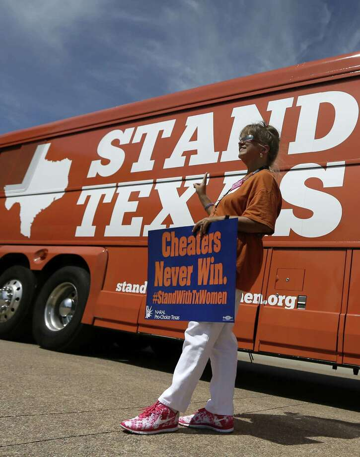 Stacey Edwards of Mesquite poses for a personal photo in front of the tour bus. Photo: Tony Gutierrez / Associated Press