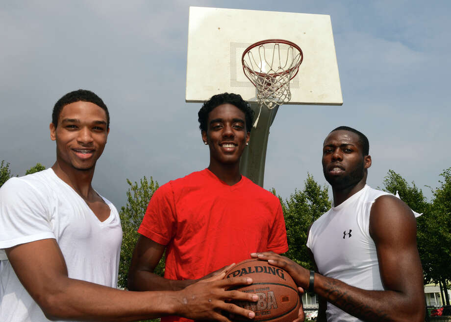 Friends Corey Baldwin, left, Jamill Powell, center, and Jerome Parkins, pose at Went Park in Bridgeport, Conn. on Wednesday July 10, 2013. Photo: Christian Abraham / Connecticut Post