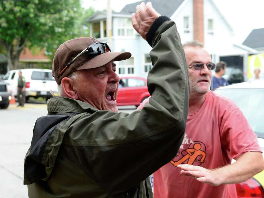 Angry citizens heckle Rail World Inc. president Edward Burkhardt  as he tours Lac-Megantic, Quebec, on Wednesday, July 10, 2013.  A Rail World oil train train crashed into the town, killing at least 15 people. (AP Photo/The Canadian Press, Paul Chiasson) ORG XMIT: RYR211 Photo: Paul Chiasson / CP