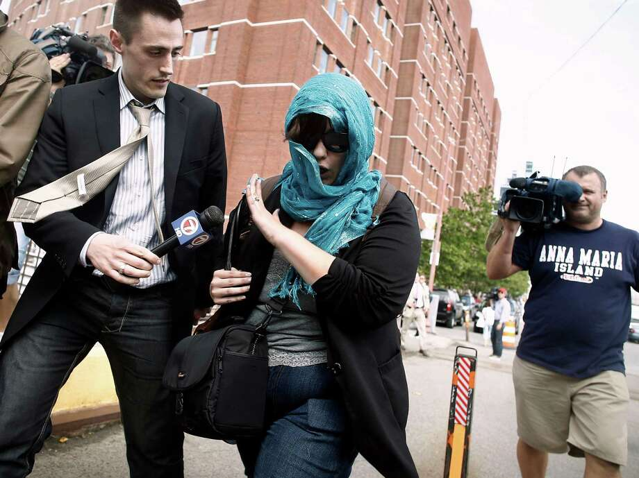 A supporter of Boston Marathon bombing suspect Dzhokhar Tsarnaev leaves federal court after his arraignment Wednesday, July 10, 2013, in Boston. The April 15 attack killed three and wounded more than 260. The 19-year-old Tsarnaev has been charged with using a weapon of mass destruction, and could face the death penalty. (AP Photo/Winslow Townson) ORG XMIT: MAWT107 Photo: Winslow Townson / FR170221 AP