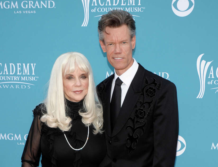 Travis shown with his then-wife Elizabeth at the 45th Annual Academy of Country Music Awards in Las Vegas in 2010. (AP photo) Photo: Dan Steinberg, AP / AP2010