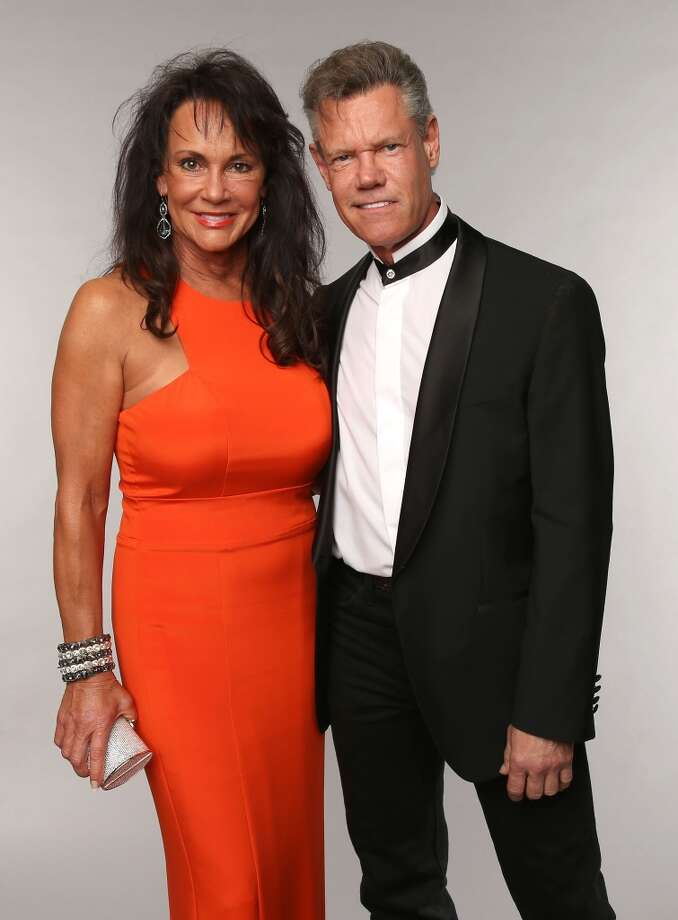 Singer Randy Travis and Mary Beougher pose at the Wonderwall portrait studio during the 2013 CMT Music Awards at Bridgestone Arena on June 5, 2013 in Nashville, Tennessee.  (Photo by Christopher Polk/Getty Images for Wonderwall)