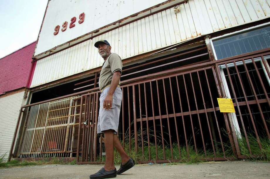 Otis Myles, president of a nearby civic club, says neighbors of the dilapidated former Kmart will be glad to see it demolished. Photo: Brett Coomer, Staff / © 2013 Houston Chronicle