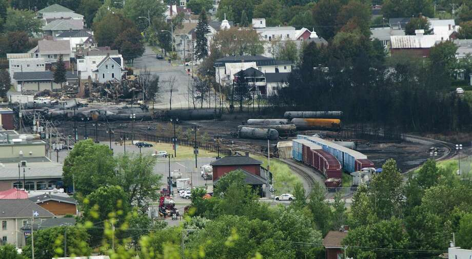The chairman of the railway whose cars derailed and destroyed much of the center of the Canadian town of Lac-Mégantic said the engineer apparently lied to the company about whether hand brakes had been set. Photo: Steeve Duguay / AFP / Getty Images