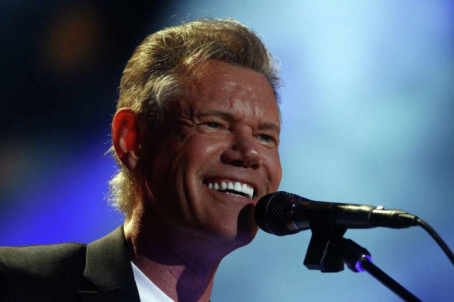 FILE - In this June 7, 2013 file photo, Randy Travis performs on day 2 of the 2013 CMA Music festival at the LP Field in Nashville, Tenn. Publicist Kirt Webster on Wednesday night, July 10, 2013 said that the 54-year-old Travis is in surgery after suffering a stroke while he was being treated for congestive heart failure because of a viral illness. (Photo by Wade Payne/Invision/AP, File) Photo: Wade Payne, INVL / Invision