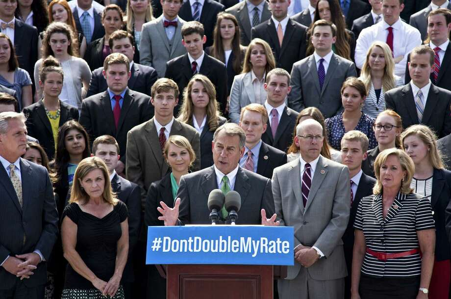 With a backdrop of college students on the step of the House of Representatives, Speaker John Boehner of Ohio and other GOP leaders talk about the politics of federal student loan rates. Photo: J. Scott Applewhite / Associated Press