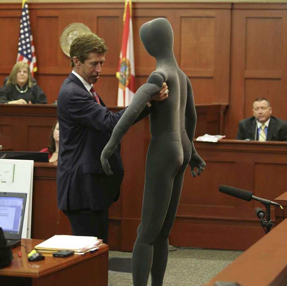 Defense attorney Mark O'Mara uses a foam dummy to describe the altercation between George Zimmerman and Trayvon Martin. Photo: Gary W. Green / Orlando Sentinel