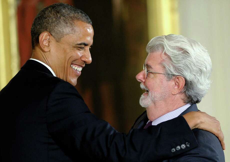 Embracing The Force, President Barack Obama presented director George Lucas with the National Medal of Arts on Wednesday at the White House. Photo: Susan Walsh, STF / AP