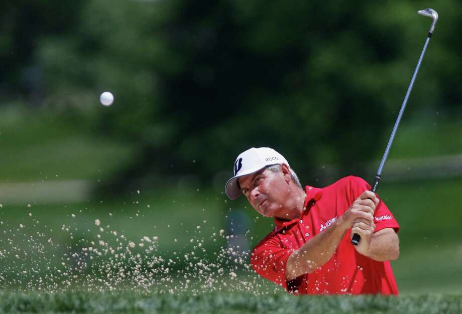 Fred Couples practices chipping out of a sand trap Wednesday, July 10, 2013, at the Omaha Country Club ahead of the U.S. Senior Open golf tournament in Omaha, Neb.,  First round of the golf competition begins on Thursday. (AP Photo/Nati Harnik) ORG XMIT: NENH106 Photo: Nati Harnik / AP