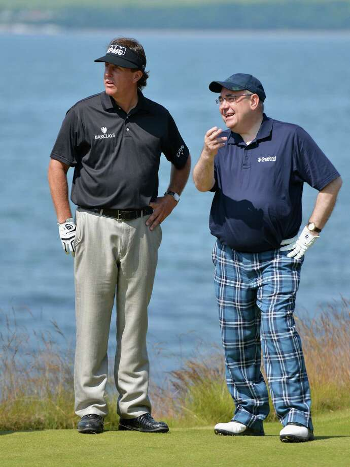 INVERNESS, SCOTLAND - JULY 10:  Scotland First Minister Alex Salmond chats to Phil Mickelson of the USA (L) during a Pro-Am round ahead of the Aberdeen Asset Management Scottish Open at Castle Stuart Golf Links on July 10, 2013 in Inverness, Scotland.  (Photo by Warren Little/Getty Images) ORG XMIT: 168873372 Photo: Warren Little / 2013 Getty Images