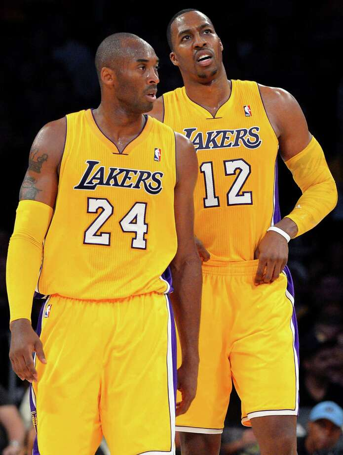 Los Angeles Lakers guard Kobe Bryant (24) and center Dwight Howard (12) appear during the first half of their preseason NBA basketball game against the Sacramento Kings, Sunday, Oct. 21, 2012, in Los Angeles. (AP Photo/Mark J. Terrill) Photo: Mark J. Terrill / AP