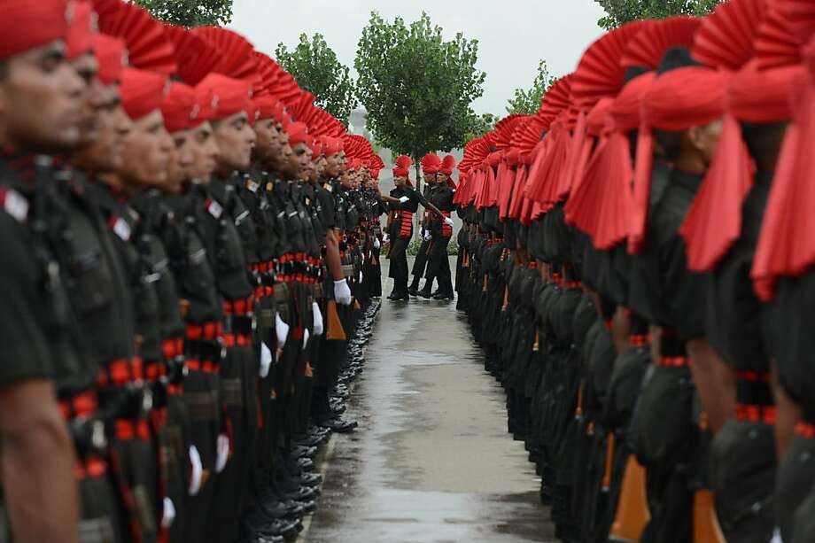 Recruits from the Jammu and Kashmir Light Infantry Regiment (JAKLI) of the Indian Army take part in a passing out parade in Srinagar on July 10, 2013.  The 494 recruits, many of them locals, completed a 49-week training programme prior to being absorbed as regular members of the regiment.  AFP PHOTO/Tauseef MUSTAFATAUSEEF MUSTAFA/AFP/Getty Images Photo: Tauseef Mustafa, AFP/Getty Images