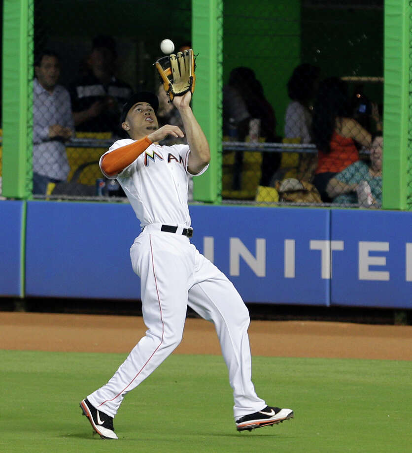 Miami Marlins right fielder Giancarlo Stanton prepares to catch a fly ball by Atlanta Braves Paul Maholm in the fifth inning of a baseball game, Wednesday, July 10, 2013, in Miami. (AP Photo/Alan Diaz) ORG XMIT: FLAD107 Photo: Alan Diaz / AP