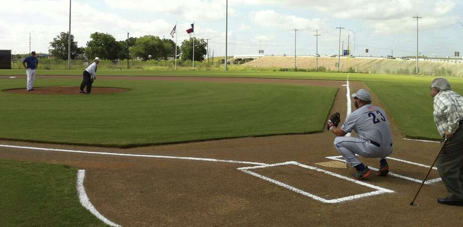 Bexar County Judge Nelson Wolff throws the first pitch at the Missions Baseball Academy. Photo: Eva Ruth Moravec / San Antonio Express-News