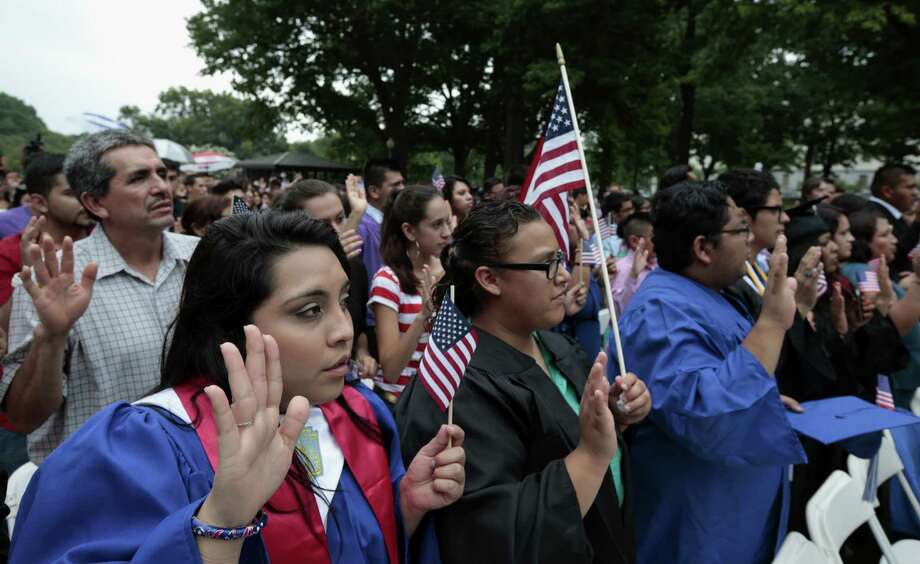 "Supporters of immigration reform participate in a mock citizenship ceremony during a ""United we Dream,"" rally Wednesday afternoon on Capitol Hill. Photo: Alex Brandon / Associated Press"